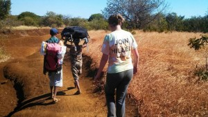 Kim hiking to a rural village to undertake research.