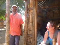 Kim meeting with a village elder in a rural village while doing research.