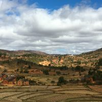 Small villages dot rice field landscapes as you drive south from Antananarivo through the rolling hills of Madagascar's Highlands. Photo by Lynne Venart.