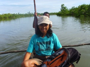 Sylviane Taking a pirogue to reach the study site