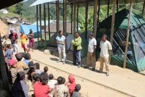 Mad Dog volunteers speaking with a local community in Madagascar.