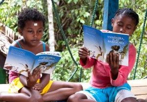 Children read books about lemurs at the celebration at Parc Ivoilina. Photo courtesy of the Madagascar Fauna & Flora Group.