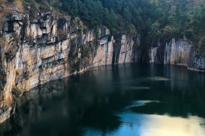 The sheer rock walls and beautiful water of Lake Tritriva. Photo by Lynne Venart.
